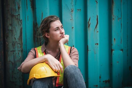 Coronavirus Covid-19 Epidemic Impact Unemployed of Labor, Woman Worker Feeling Hopeless after Her Company Lay-Off From Covid19 Crisis. Business Downturn From Coronavirus Situation and Unemployment Stock Photo
