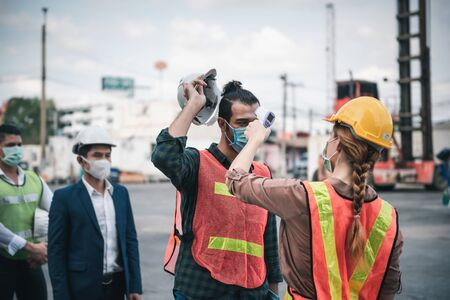 Coronavirus Covid-19 Disease Epidemic Crisis Situation, Construction Worker Having Fever Body Scan by Thermometer Scanning at Construction Site. Corona-Virus Covid19 Prevention of New Normal Concept