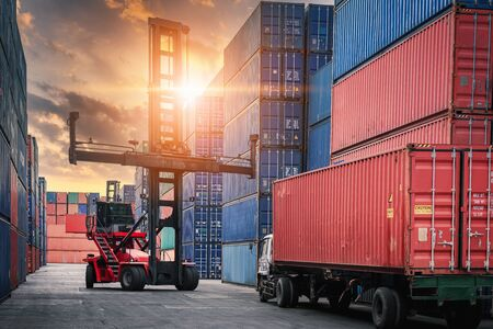 Container Cargo Port Ship Yard Storage of Logistic Transportation Industry. Forklift is Stacking Containers of Freight Import/Export Shipment. Business Shipping Logistics Service Transport Industrial Stock Photo