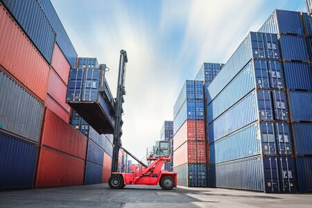 Container Ship Loading of Import/Export Freight Transportation Industry, Transport Crane Forklift is Lifting Box Containers at Port Cargo Shipping Dock Yard. Logistic Freighting Ship Service