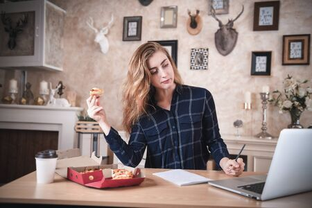 Busy Businesswoman Work at Home While Working on Table Desk With Laptop at The Same Time She Eating, Business Woman Entrepreneur Work From Home With Serious Communicating Busy Tasking. Work Lifestyles
