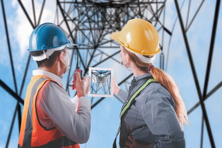 Construction/Electrical Engineer Builder Teamwork Inspection Civil Work at Construction Site, Engineering Inspector Team in Safety Equipment Discuss Constructing Plan for Structural Electricity Pole