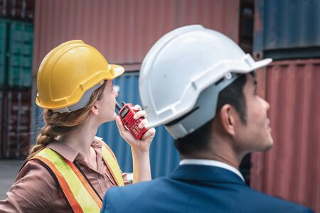 Business Team Container Cargo Shipping Control Inspection Loading Dock and Management Import/Export Freight at Port Ship Yard. Manager and Foreman Teamwork Inspecting Containers Shipment Warehouse. Stockfoto