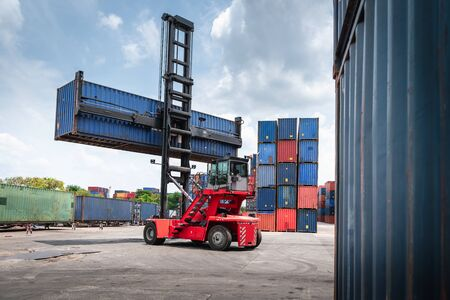 Container Cargo Port Ship Yard Storage of Logistic Transportation Industry. Forklift is Stacking Containers of Freight Import/Export Shipment. Business Shipping Logistics Service Transport Industrial