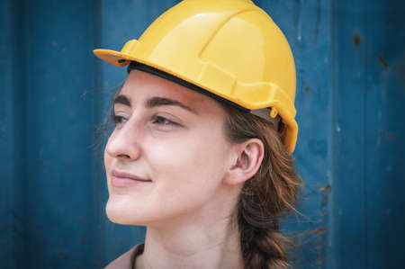 Portrait of Confident Transport Engineer Woman in Safety Equipment Standing in Container Ship Yard. Transportation Engineering Management and Container Logistics Industry, Shipping Worker Occupation