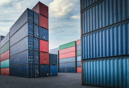 Container Cargo Port Ship Yard Storage Handling of Logistic Transportation Industry. Row of Stacking Containers of Freight Import/Export Distribution Warehouse. Shipping Logistics Transport Industrial 写真素材