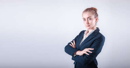 Portrait Attractive of Business Woman Executive Standing Against Isolated Background, Close-Up of Businesswoman in Formal Suit With Arms Crossed on Gray Backgrounds. Finance Employee Occupation