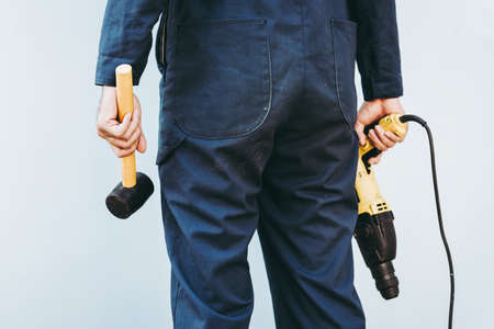 Construction Worker Holding Constructing Equipment Tools on Isolated Background. Carpenter Man Builder Real Estate Jobs Occupation, Business Engineering Industry and Building Development Concept.
