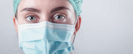 Medical Surgical Doctor and Health Care, Portrait of Surgeon Doctor in PPE Equipment on Isolated Background. Medicine Female Doctors Wearing Face Mask and Cap for Patients Surgery Work. Medic Hospital