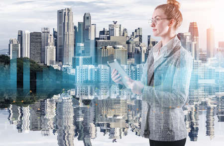 Business Woman Using Tablet on City Urban Background, Double Exposure of Businesswoman With Financial Marketing Report Data Against Cityscape Building Backgrounds. Business Digital Finance/Technology Imagens
