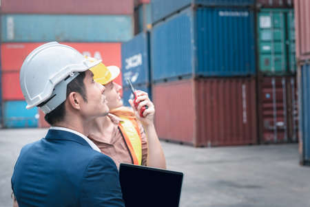 Container Shipping Logistics Engineering of Import/Export Transportation Industry, Transport Engineers Teamwork Controlling Management Containers Together at Port Ship Loading Dock. Business Team