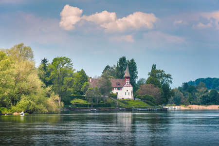 Natural Scenery and Swiss Church Culture at Stein Am Rhein City, Switzerland. Beautiful Nature Waterfront View of Rhine River With Architecture Historical Church Building at Summer. Travel Destination