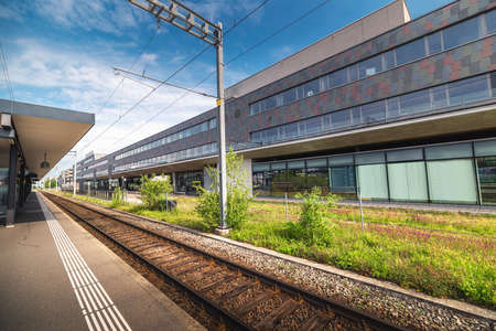 Train Station Platform in Urban Zurich City, Switzerland, Public Metro Transit and Infrastructure of Swiss Trains. Perspective View of Railway and Modern Architecture Building Background. Swiss Travel Imagens