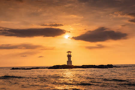 Seascape Scenery View With Lighthouse During Dramatic Cloudy at Sunset, Nature Landscape Tropical Seashore Scenic and Beautiful Beach Against Horizon Over The Sea Water. Natural Panoramic of The Beach