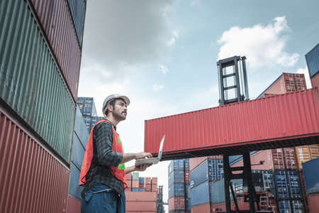 Container Supervisor Control Import/Export While Inspecting Containers Box in Warehouse Storage Distribution. Container Logistics Shipping Controlling of Transportation Industry, Cargo Ship Factory Imagens