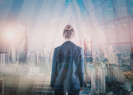 Business Property Development and Investment Concept, Double Exposure of Businesswoman Rear View and Cityscape Buildings. Goal Business Executive Marketing of Successful Entrepreneur Imagens