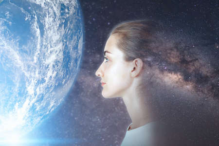 Futuristic Goal and Solution Thinking Concept, Double Exposure Overlay Images of Attractive Woman Portrait With Galaxy Space and Planet Earth. Imagens