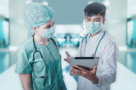 Doctor Team Discussion Patient Diagnosis Report on Tablet Against Patients Ward Background, Group of Doctors Teamwork in Medical Equipment Working in Clinic Surgical Hospital. Healthcare/Medicine