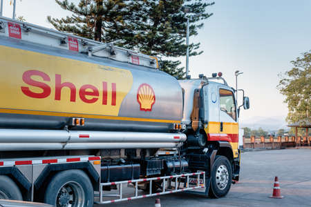 Chiang Mai, Thailand - Dec 15, 2020: Shell Gas Station and Trailer Truck During Sunset. Royal Dutch Shell Oil and Gas Industry Production, Refining, Transport, Marketing, Petrochemical and Trading.