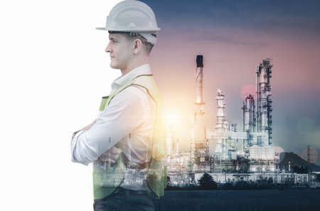 Manufacturing Oil-Gas Industry and Engineering Futuristic Concept, Double Exposure of Construction Engineer With Safety Equipment and Oil Refinery Plant Background. Business Construction Industrial Imagens
