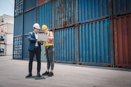 Container Shipping Logistics Engineering of Import-Export Transportation Industry, Transport Engineers Teamwork Controlling Management Containers Together at Port Ship Loading Dock. Business Team 스톡 콘텐츠