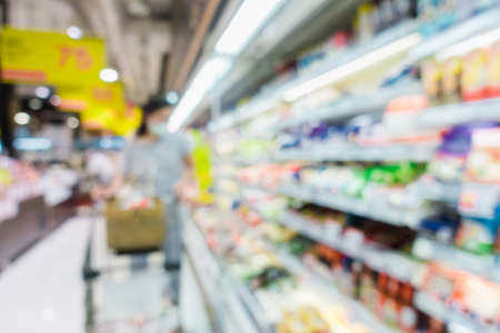 Abstract Defocused Blurred of Consumer Goods and Shopping Cart in Supermarket Store, Shop Trolley Basket in Department Store. Business Retail and Customer Shopping Mall Service, Convenience Concept.