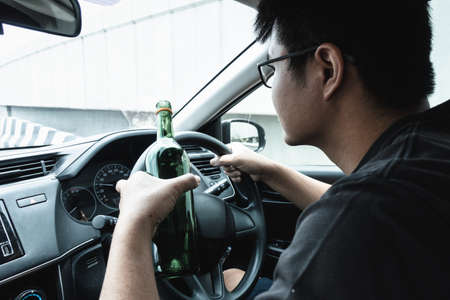 Man Driver Drinking Alcohol and Drunk While Driving a Car, Drunken Man Lose Control and Visual Visibility During Drive a Vehicle Car. Illegal Violation and Accident Risk.
