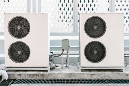 Cooling Air Condition Unit and Control System, Air Condenser Engine Station Outside Building of HVAC Systems. Electrical Compressor Fan Coil of Air Conditioning Equipment for Home Residential Units.