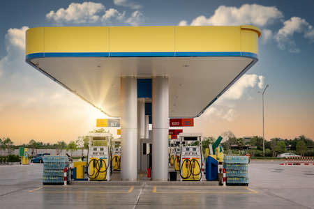 Gas Station and Car Service at Sunset, Business Entrepreneur Fuel Energy. Vehicle Gasoline Stations for Motor Convenience Beside Highway Road. Industry Petrol Power and Auto Services