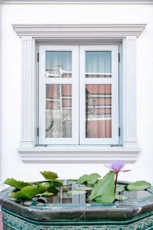 Front View of Window Vintage Styles With Exterior Decoration, Double Transparent Glass Windows and Architecture Facade Design. Residential Home Window With Reflection