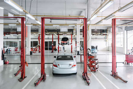Car Auto Service and Vehicle Maintenance Workshop Center, Automobile Garage Shop and Spare Part Changing. Automotive Services Station. Business Car Repair and Check Up