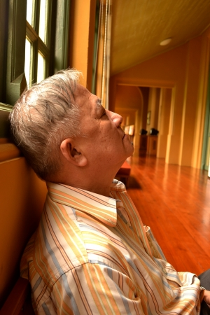 the napping of old man photo