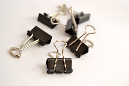 nip: Black clerical clips for nip paper with white background