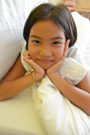 smiling girl on the bed photo
