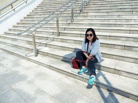 sit: Girl sit on the stair stadium