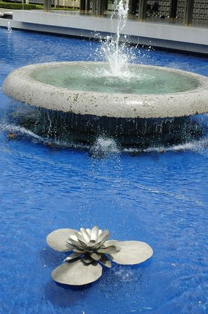 Water fountain in the shape of steel lotus flower Stock Photo