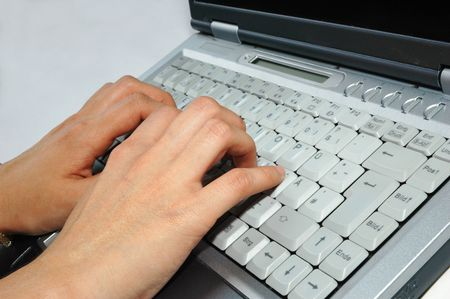 Fingers typing laptop  keyboard  notebook