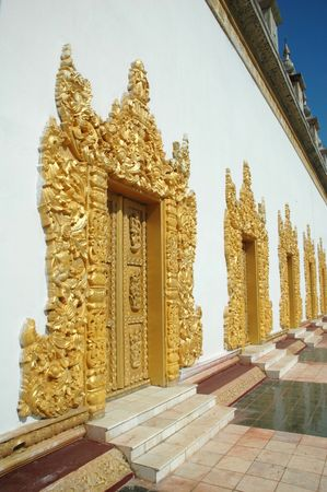 Temple doors with golden grand carving decoration