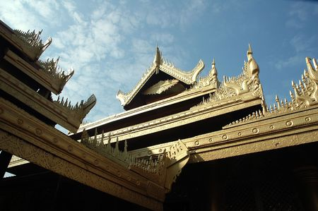 The intricate carvings on the roof of Mandalay Palace, Myanmar