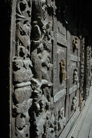 Ancient wood carvings of a wall temple architecture Stock Photo