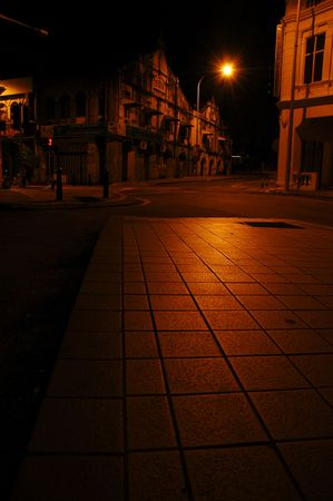 Old shophouses and quiet street at night