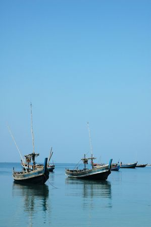 Few old wooden boats docked at the sea