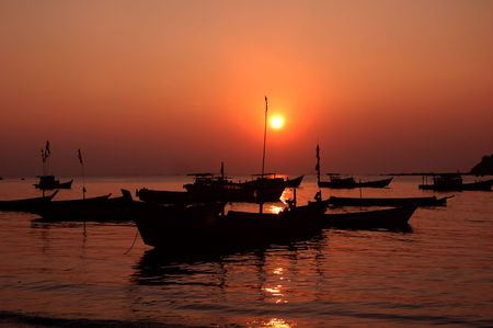 Silhouette of boats at sea during sunset Stock Photo