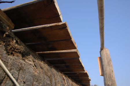 Wooden plank walkway view from below against clear blue sky Stock Photo