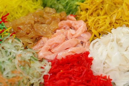 A special dish during Chinese New Year called Yusheng or Yee Sang with low depth of field photo