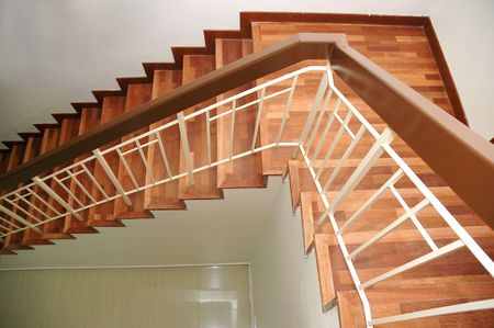 Wooden staircase with railings from top view Stock Photo