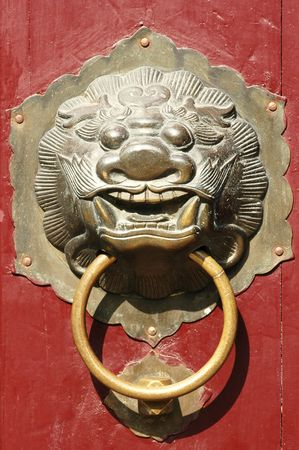 Close up of traditional oriental Chinese lion door knob