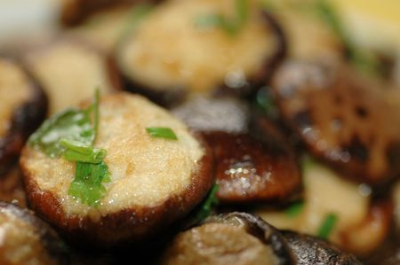 Delicious Asian Chinese cuisine of fish paste stuffed mushroom with parsley photo