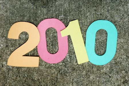 Colorful textured new year 2010 on a grunge rough background Stock Photo
