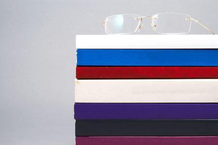 academia: eyeglass on white